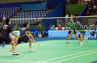 A photo of a badminton match.