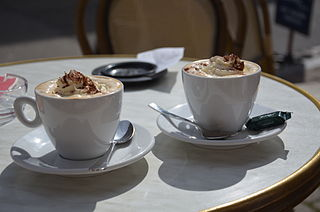 Two Viennese coffees served on a terrace.
